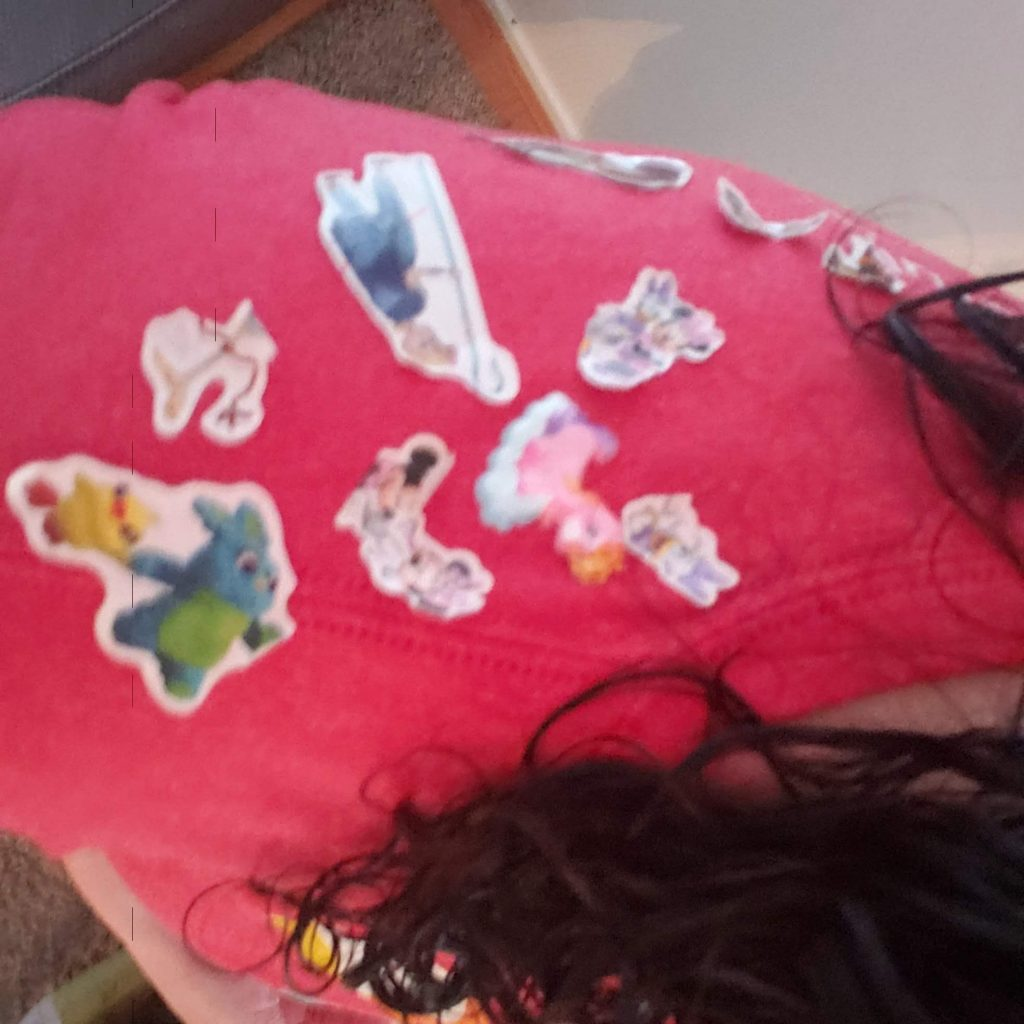 A red shirt covered in Toy Story stickers